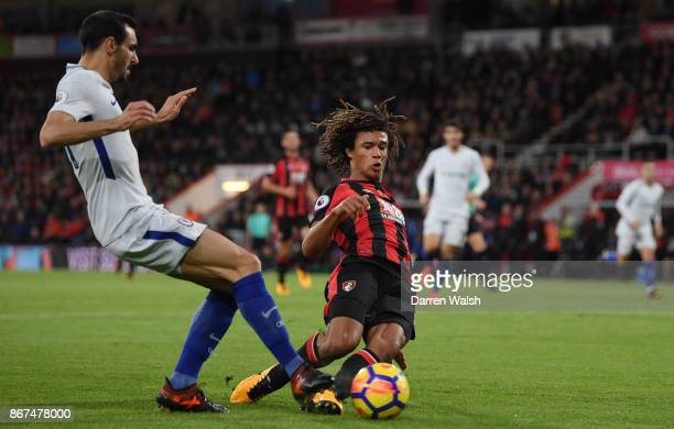Davide Zappacosta of Chelsea and Nathan Ake of AFC Bournemouth battle for possession during the Premier League match between AFC Bournemouth and...