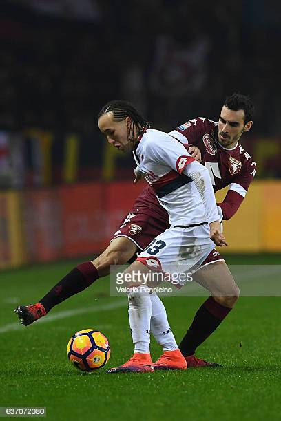 Davide Zappacosta of FC Torino competes with Diego Laxalt of Genoa CFC during the Serie A match between FC Torino and Genoa CFC at Stadio Olimpico di...