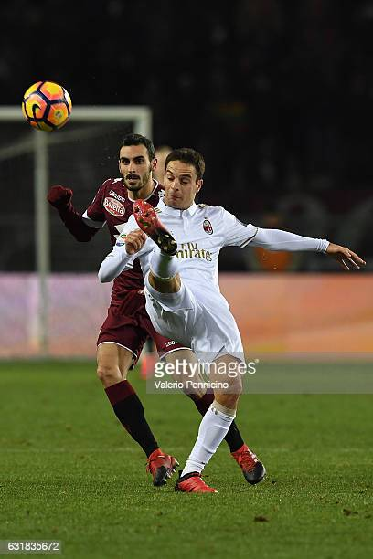 Davide Zappacosta of FC Torino competes with Giacomo Bonaventura of AC Milan during the Serie A match between FC Torino and AC Milan at Stadio...
