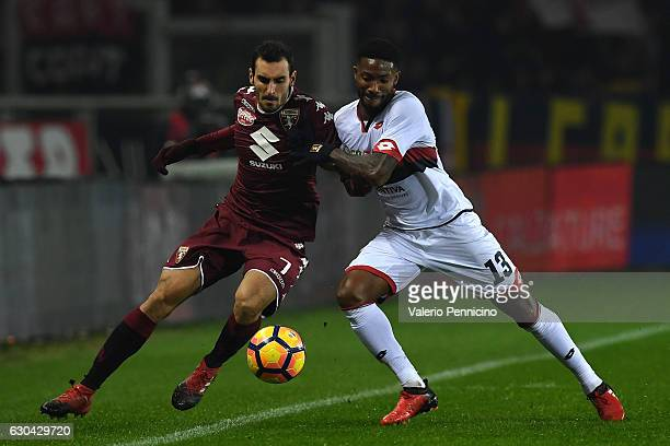 Davide Zappacosta of FC Torino competes with Serge Gakpe of Genoa CFC during the Serie A match between FC Torino and Genoa CFC at Stadio Olimpico di...
