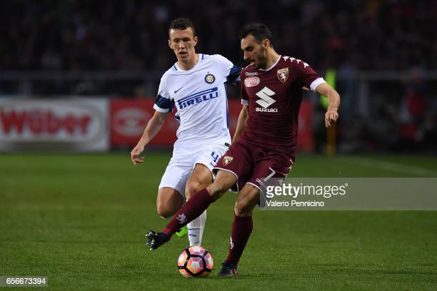 Davide Zappacosta of FC Torino in action against Ivan Perisic of FC Internazionale during the Serie A match between FC Torino and FC Internazionale...