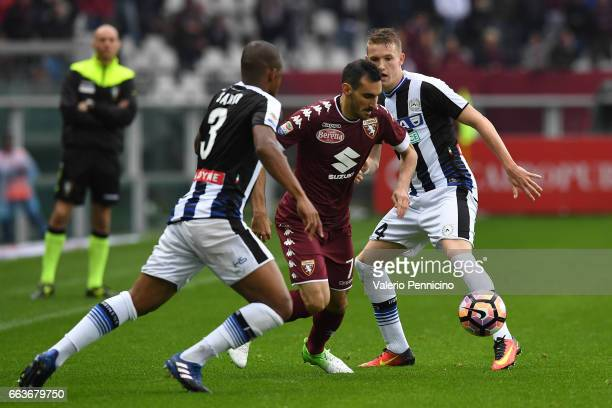 Davide Zappacosta of FC Torino in action against Jakub Jankto and Samir of Udinese Calcio during the Serie A match between FC Torino and Udinese...