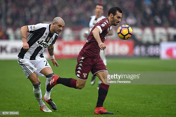 Davide Zappacosta of FC Torino in action against Stefano Sturaro of Juventus FC during the Serie A match between FC Torino and Juventus FC at Stadio...