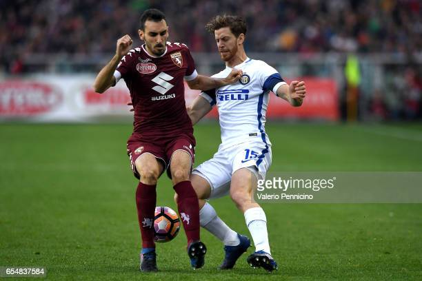 Davide Zappacosta of FC Torino is challenged by Cristian Ansaldi of FC Internazionale during the Serie A match between FC Torino and FC...