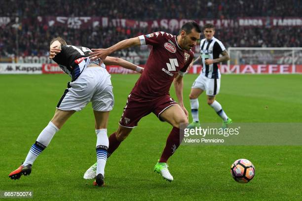 Davide Zappacosta of FC Torino is challenged by Jakub Jankto of Udinese Calcio during the Serie A match between FC Torino and Udinese Calcio at...