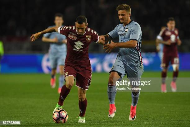 Davide Zappacosta of FC Torino is challenged by Karol Linetty of UC Sampdoria during the Serie A match between FC Torino and UC Sampdoria at Stadio...