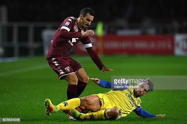 Davide Zappacosta of FC Torino is tackled by Lucas Nahuel Castro of AC ChievoVerona during the Serie A match between FC Torino and AC ChievoVerona at...