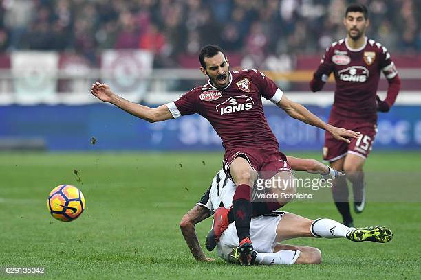 Davide Zappacosta of FC Torino is tackled by Mario Mandzukic of Juventus FC during the Serie A match between FC Torino and Juventus FC at Stadio...