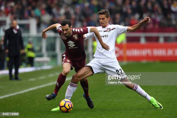 Davide Zappacosta of FC Torino is tackled by Norbert Balogh of US Citta di Palermo during the Serie A match between FC Torino and US Citta di Palermo...