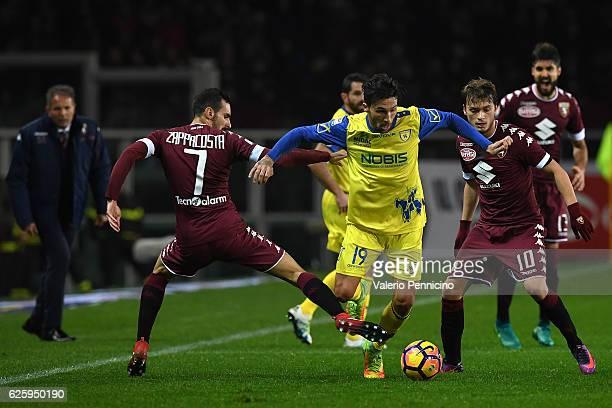 Davide Zappacosta of FC Torino tackles Lucas Nahuel Castro of AC ChievoVerona during the Serie A match between FC Torino and AC ChievoVerona at...