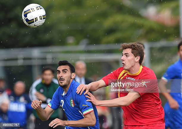 L'AQUILA ITALY JUNE 04 Davide Zappacosta of Italy and Luka Dordevic of Montenegro in action during the international friendly match between Italy U21...