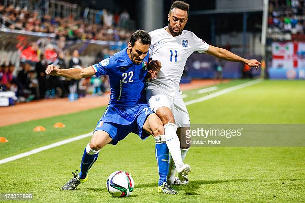 Davide Zappacosta of Italy competes for the ball with Nathan Redmond of England during the UEFA Under21 European Championship 2015 match between...