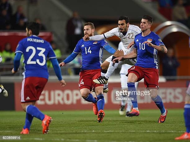 Davide Zappacosta of Italy competes for the ball with Yves Oehrir and Sandro Wieser of Liechtenstein during the FIFA World Cup 2018 group G...