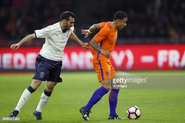 Davide Zappacosta of Italy Memphis Depay of Hollandduring the friendly match between Netherlands and Italy at the Amsterdam Arena on March 28 2017 in...