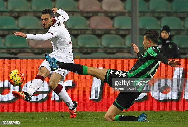 Davide Zappacosta of Torino FC is challenged by Federico Peluso of US Sassuolo Calcio during the Serie A match betweeen US Sassuolo Calcio and Torino...