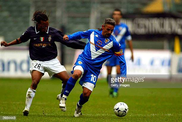 Davids of Juventus challenges Roberto Baggio of Brescia during the Italian A 7th round match between Juventus and Brescia at delle alpi stadium...