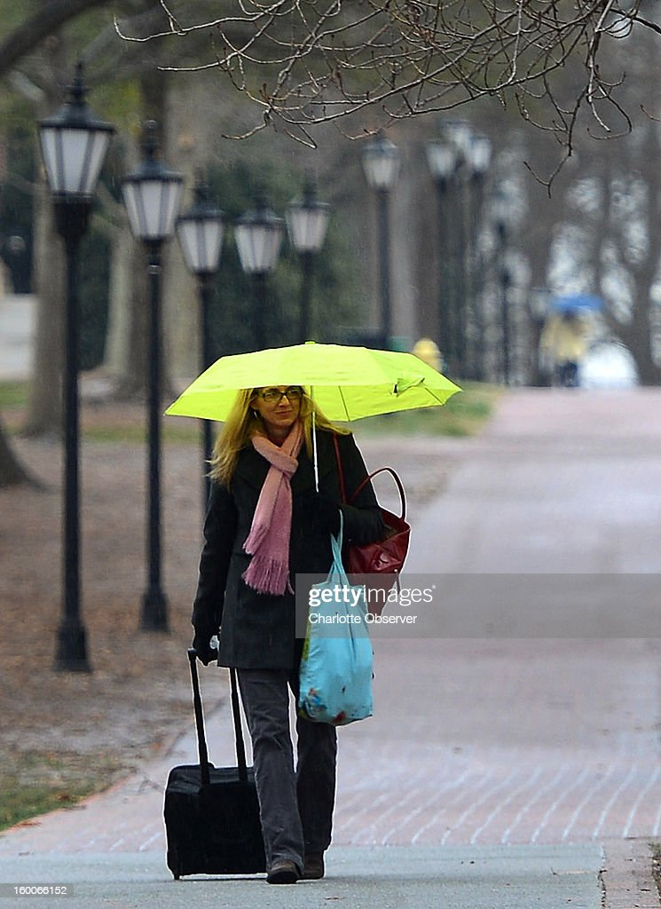 Davidson College professor Angela Willis walks across campus toward the intersection of Main St. and Depot St. in Davidson, North Carolina, as sleet falls, Friday, January 25, 2013. Willis is a professor in the Hispanic Studies department at Davidson College and cancelled her afternoon class because it was better to be safe.