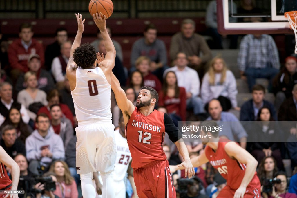 Davidson Guard Jack Gibbs (12) reaches to defend a shot by Saint Joe's Guard Lamarr Kimble (0) in the first half during the game between the Davidson College Wildcats and Saint Joseph's University Hawks on January 31, 2017 at Hagan Arena in Philadelphia, PA.