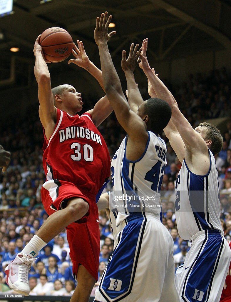 Davidson guard Stephen Curry (30) attempts to shoot over Duke defenders forward Lance Thomas (42) and forward Kyle Singler (12) in the second half at Cameron Indoor Stadium in Durham, North Carolina, Wednesday, January 7, 2009. Duke defeated Davidson, 79-67.