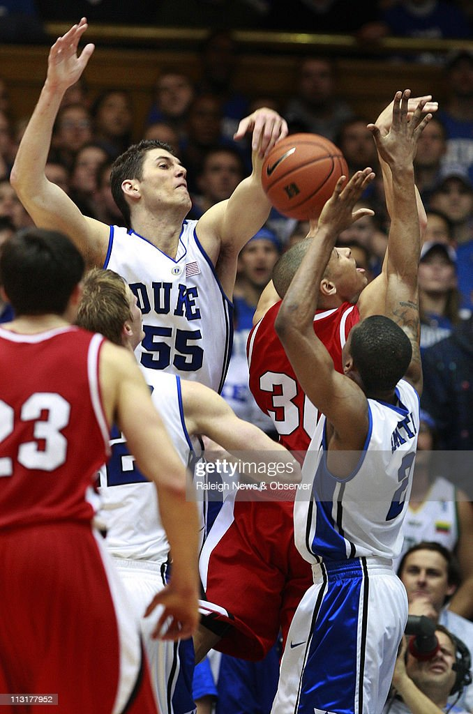 Davidson guard Stephen Curry (30) has his shot blocked by Duke center Brian Zoubek (55) during the first half at Cameron Indoor Stadium in Durham, North Carolina, Wednesday, January 7, 2009. Duke defeated Davidson, 79-67.