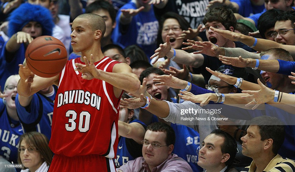 Davidson guard Stephen Curry (30) is harassed by the Cameron Crazies during first half of action at Cameron Indoor Stadium in Durham, North Carolina, Wednesday, January 7, 2009.
