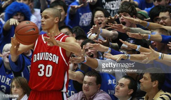 Davidson guard Stephen Curry is harassed by the Cameron Crazies during first half of action at Cameron Indoor Stadium in Durham North Carolina...