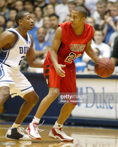 Davidson guard Terrell Ivory looks to back the ball down against Chris Duhon during first half action Duke defeated Davidson 8854 at Cameron Indoor...