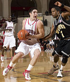 Davidson point guard Jason Richards tries to drive to the basket past Wofford's Drew Gibson during second half action at the Belk Arena in Davidson...