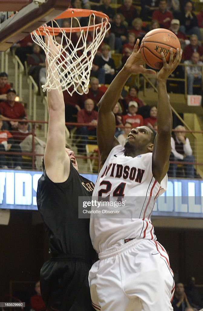 Davidson's De'Mon Brooks (24) puts up a shot against Charleston's Trent Wiedeman during the men's Southern Conference basketball tournament at the Asheville Civic Center in Asheville, North Carolina, Monday, March 11,2013.