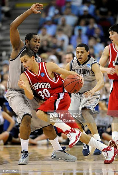 Davidson's Stephen Curry tries to find space around Georgetown's Austin Freeman and Jonathan Wallace in first half action on Sunday March 23 2008 The...