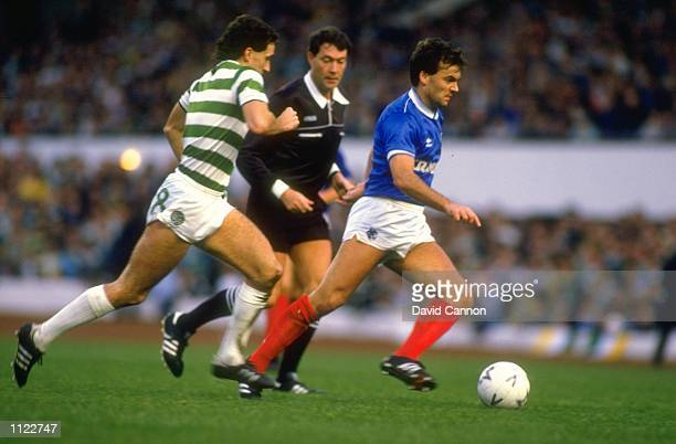 Davie Cooper of Rangers takes on Paul McStay of Celtic during the Skol Cup final at Hampden Park in Glasgow Scotland Rangers won the match 21...