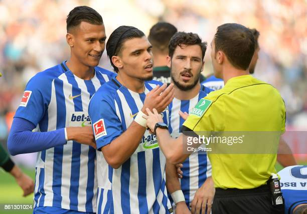 Davie Selke Karim Rekik Mathew Leckie of Hertha BSC and referee Benjamin Brand during the game between Hertha BSC and Schalke 04 on october 14 2017...