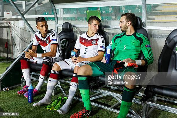 Davie Selke Marc Oliver Kempf and Goalkeeper Oliver Schnitzler rest exhausted on the substitues bench after winning the UEFA Under19 European...