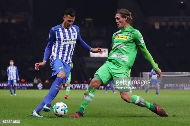 Davie Selke of Berlin fights for the ball with Jannik Vestergaard of Moenchengladbach during the Bundesliga match between Hertha BSC and Borussia...