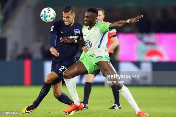 Davie Selke of Berlin is challenged by Josuha Guilavogui of Wolfsburg during the Bundesliga match between VfL Wolfsburg and Hertha BSC at Volkswagen...