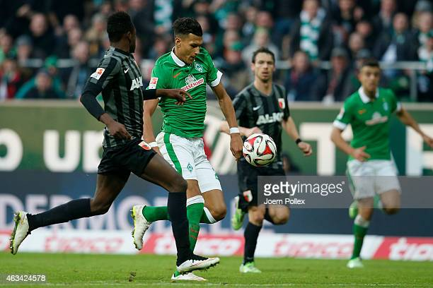 Davie Selke of Bremen and Abdul Rahman Baba and Markus Feulner of Augsburg compete for the ball during the Bundesliga match between SV Werder Bremen...