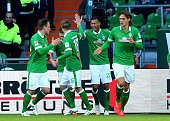 Davie Selke of Bremen celebrate with his team mates after scoring the opening goal during the Bundesliga match between SV Werder Bremen and Bayer 04...
