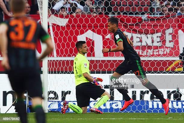 Davie Selke of Bremen celebrates his team's first goal during the Bundesliga match between VfB Stuttgart and SV Werder Bremen at MercedesBenz Arena...