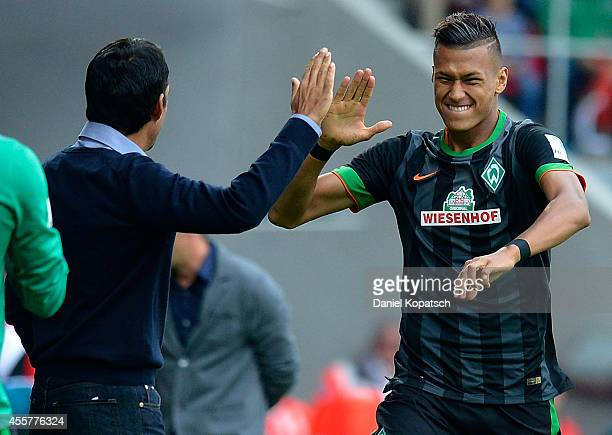Davie Selke of Bremen celebrates his team's first goal with his Coach Robin Dutt of Bremen during the Bundesliga match between FC Augsburg and SV...