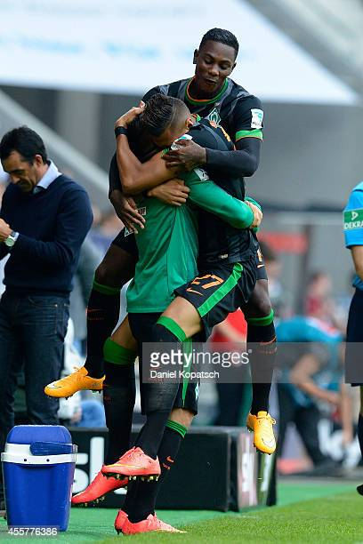 Davie Selke of Bremen celebrates his team's first goal with team mate Eljero Elia during the Bundesliga match between FC Augsburg and SV Werder...
