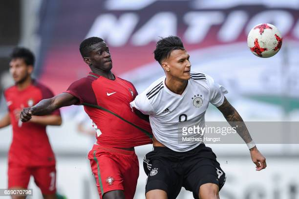 Davie Selke of Germany and Edgar Ie of Portugal battle for the ball during the U21 International Friendly match between Germany U21 and Portugal U21...