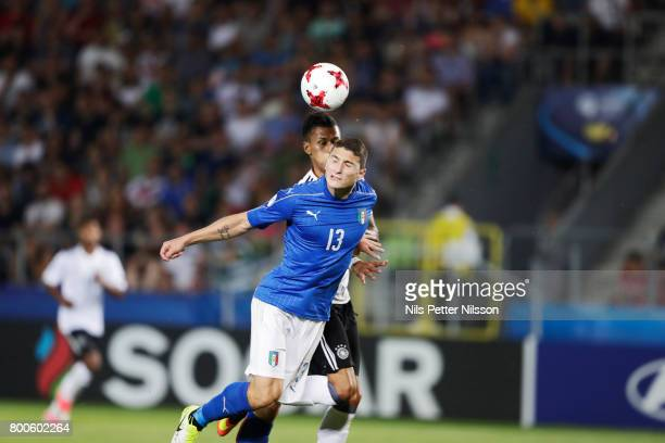 Davie Selke of Germany and Mattia Caldara of Italy competes for the ball during the UEFA U21 championship match between Italy and Germany at Krakow...