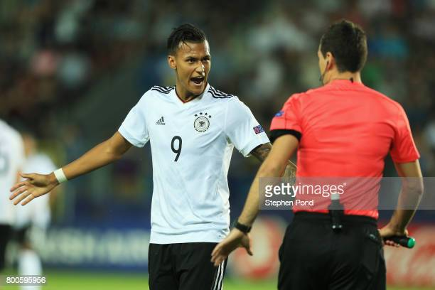 Davie Selke of Germany appeals to referee Slavko Vincic during the 2017 UEFA European Under21 Championship Group C match between Italy and Germany at...