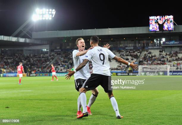 Davie Selke of Germany celebrates scoring his sides first goal with his Germany team mate during the UEFA European Under21 Championship Group C match...