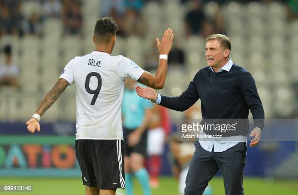 Davie Selke of Germany celebrates scoring his sides first goal with Stefan Kuntz coach of Germany during the UEFA European Under21 Championship Group...