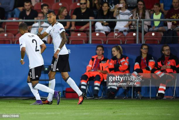 Davie Selke of Germany celebrates scoring his side's first goal with team mate Jeremy Toljan during their UEFA Under21 Championship Group C match...