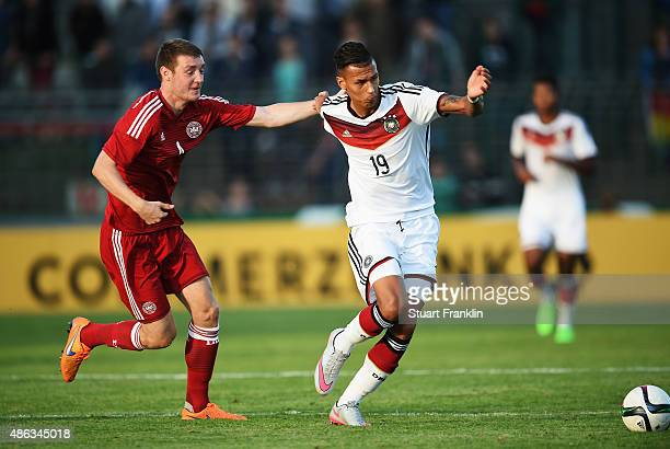 Davie Selke of Germany is challenged by Patrick Banggaard of Denmark during the International friendly match between U21 Germany and U21 Denmark at...