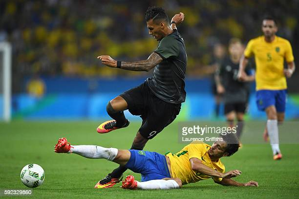 Davie Selke of Germany is challenged by Rodrigo Caio of Brazil during the Men's Football Final between Brazil and Germany at the Maracana Stadium on...