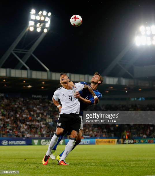 Davie Selke of Germany jumps for a header with Daniele Rugani of Italy during the UEFA European Under21 Championship Group C match between Italy and...