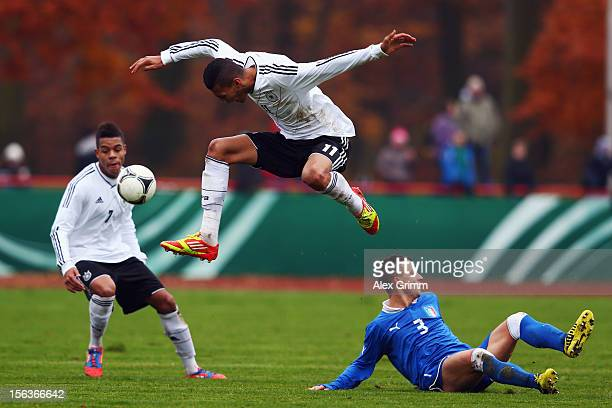 Davie Selke of Germany outjumps Filippo Costa of Italy during the U18 international friendly match between Germany and Italy at Sportpark on November...